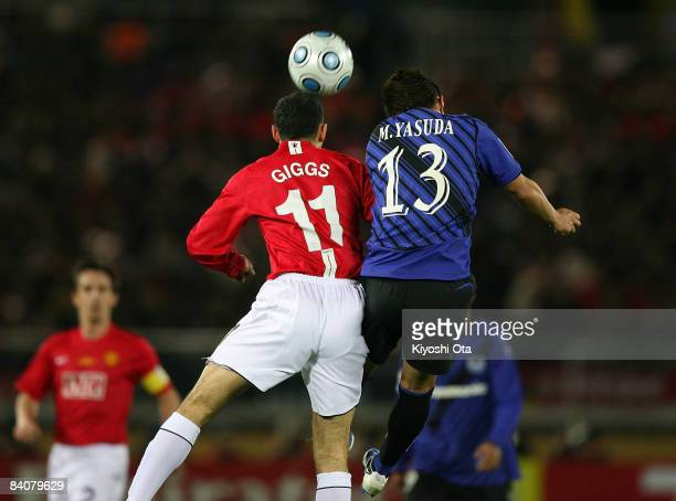 Ryan Giggs of Manchester United and Michihiro Yasuda of Gamba Osaka compete for the ball during the FIFA Club World Cup semi final match between...