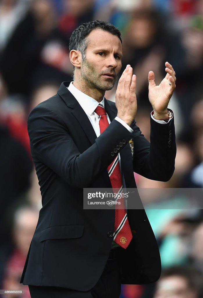 Ryan Giggs of Manchester United applauds the fans after a rousing victory in his first match as manager during the Barclays Premier League match between Manchester United and Norwich City at Old Trafford on April 26, 2014 in Manchester, England.
