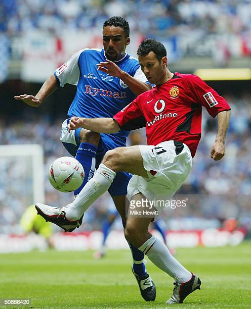 Ryan Giggs of Manchester United battles with Paul Ifill of Millwall during the 123rd FA Cup Final between Manchester United and Millwall at The...