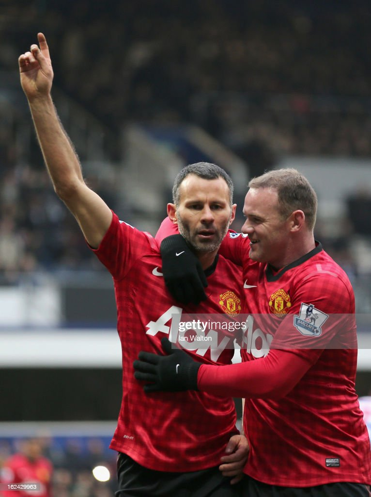 Ryan Giggs of Manchester United celebrates a goal with Wayne Rooney during the Barclays Premier League match between Queens Park Rangers and Manchester United at Loftus Road on February 23, 2013 in London, England.