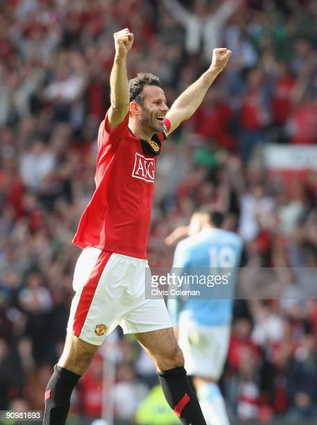 Ryan Giggs of Manchester United celebrates after the FA Barclays Premier League match between Manchester United and Manchester City at Old Trafford...