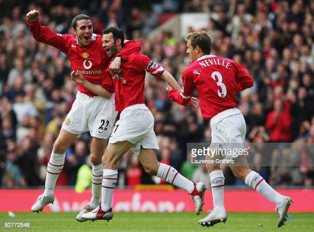 Ryan Giggs of Manchester United celebrates his goal with John O'Shea and Phil Neville during the FA Barclays Premiership match between Manchester...