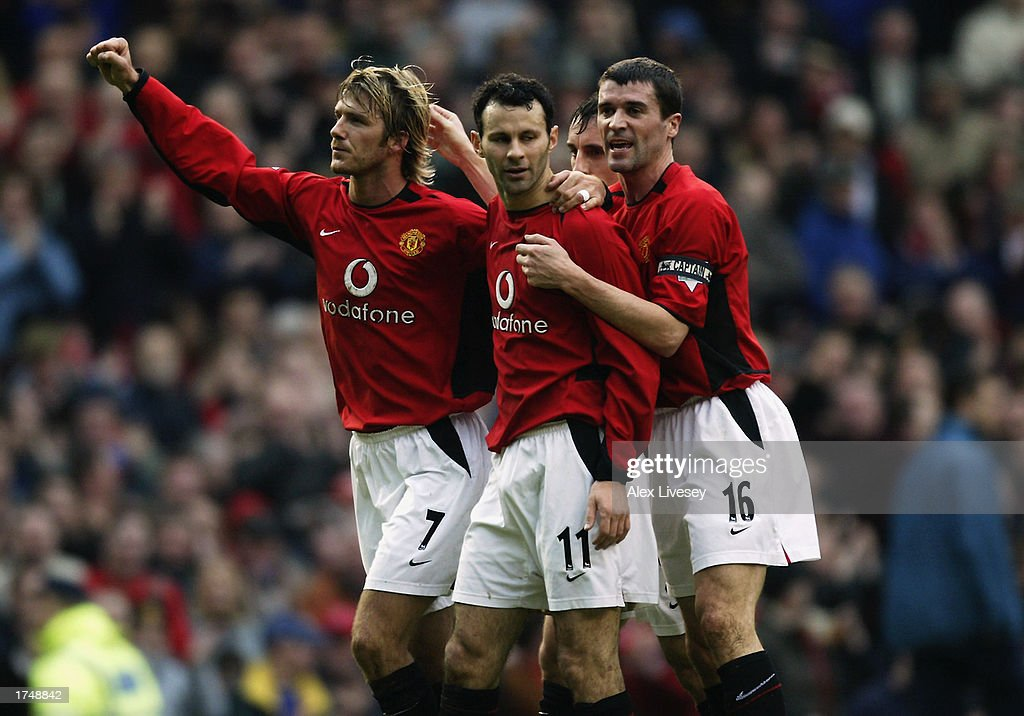 af5c4e94042 Ryan Giggs of Manchester United celebrates his goal with team-mates David  Beckham and Roy