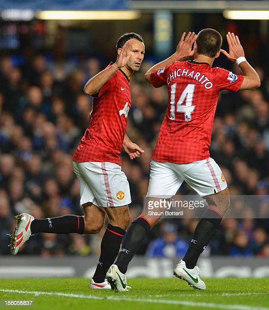 Ryan Giggs of Manchester United celebrates scoring the opening goal with Javier Hernandez during the Capital One Cup Fourth Round match between...