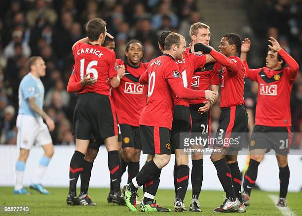 Ryan Giggs of Manchester United celebrates scoring their first goal during the Carling Cup SemiFinal First Leg match between Manchester City and...