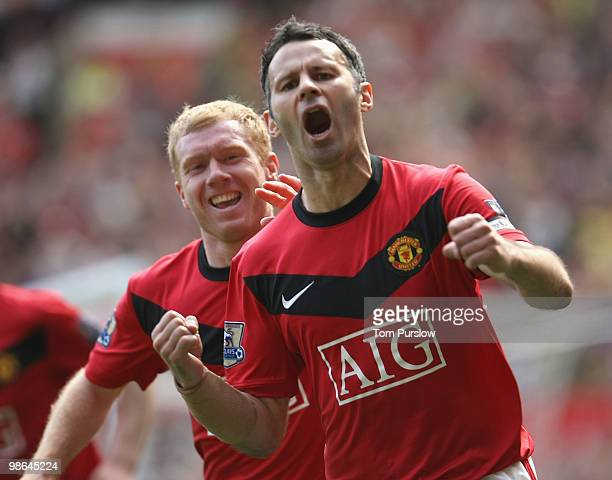 Ryan Giggs of Manchester United celebrates scoring their first goal during the Barclays Premier League match between Manchester United and Tottenham...