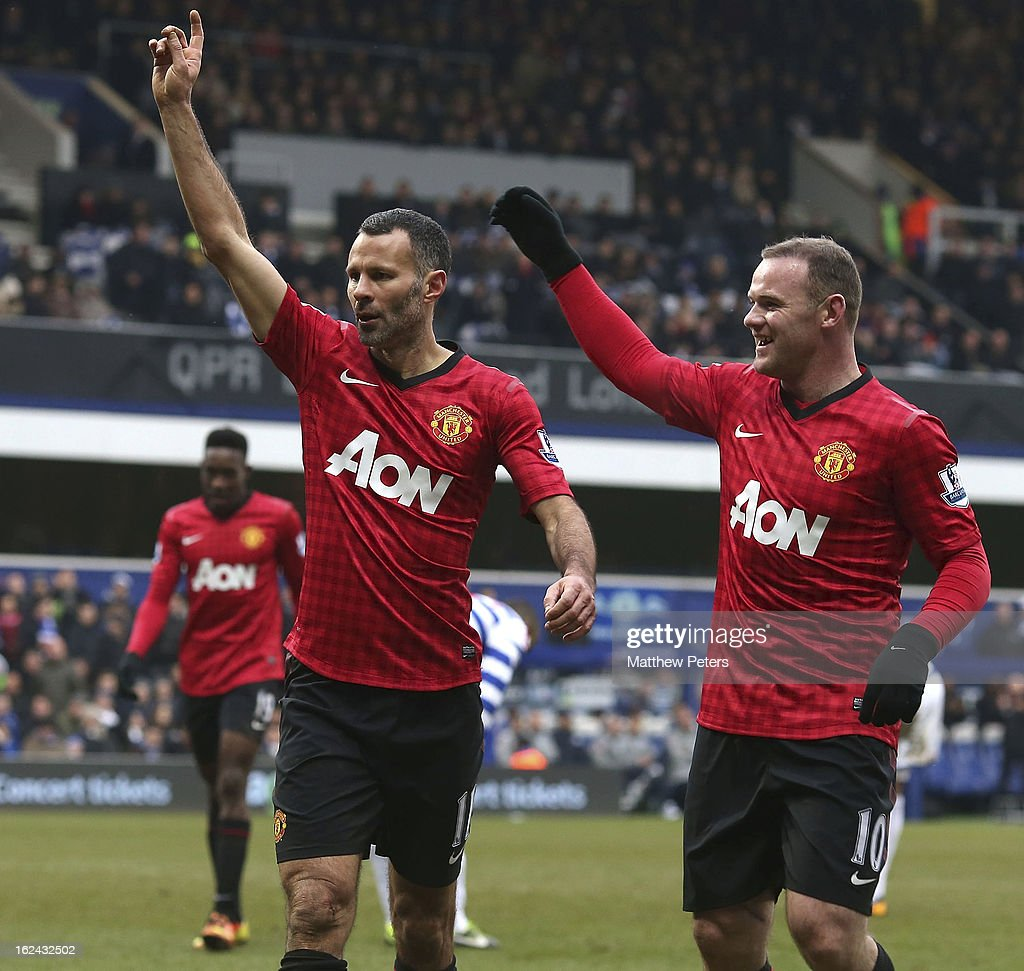 Ryan Giggs (L) of Manchester United celebrates scoring their second goal during the Barclays Premier League match between Queens Park Rangers and Manchester United at Loftus Road on February 23, 2013 in London, England.
