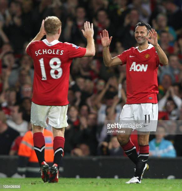 Ryan Giggs of Manchester United celebrates scoring their third goal during the Barclays Premier League match between Manchester United and Newcastle...