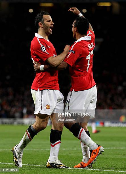 Ryan Giggs of Manchester United celebrates setting up the opening goal with team mate Nani during the UEFA Champions League Quarter Final second leg...