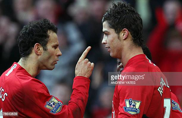 Ryan Giggs of Manchester United celebrates with Cristiano Ronaldo after Ronaldo's penalty winning the match 20 during the Premier league football...