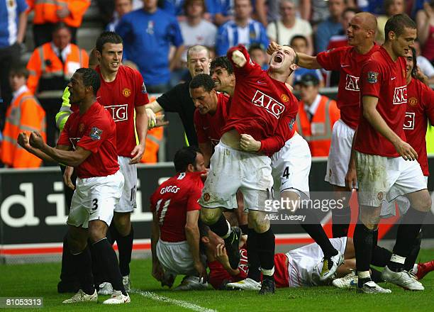 Ryan Giggs of Manchester United celebrates with his team mates after scoring his team's second goal during the Barclays Premier League match between...