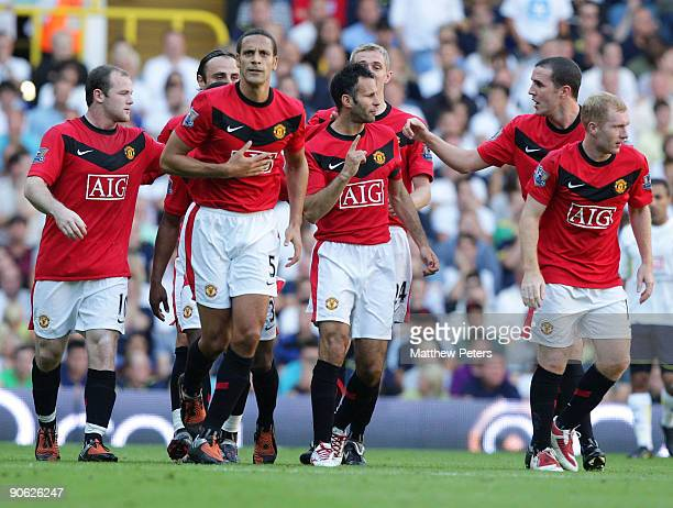 Ryan Giggs of Manchester United celebrates with his team mates after scoring their first goal during the FA Barclays Premier League match between...