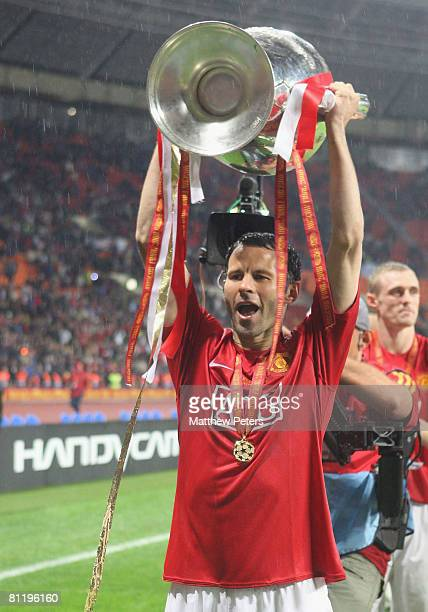 Ryan Giggs of Manchester United celebrates with the trophy after winning the UEFA Champions League Final match between Manchester United and Chelsea...