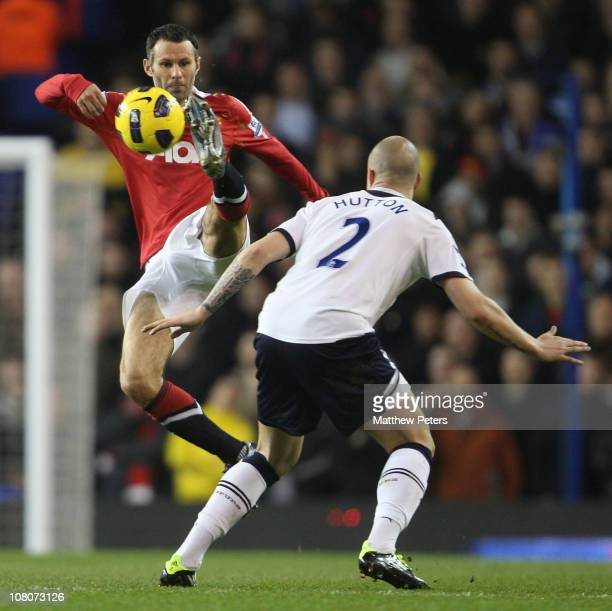 Ryan Giggs of Manchester United clashes with Alan Hutton of Tottenham Hotspur during the Barclays Premier League match between Tottenham Hotspur and...