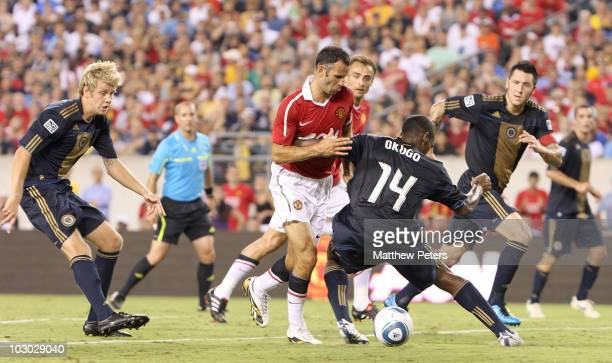 Ryan Giggs of Manchester United clashes with Amobi Okugo of Philadelphia Union during the pre-season friendly match between Philadelphia Union and...