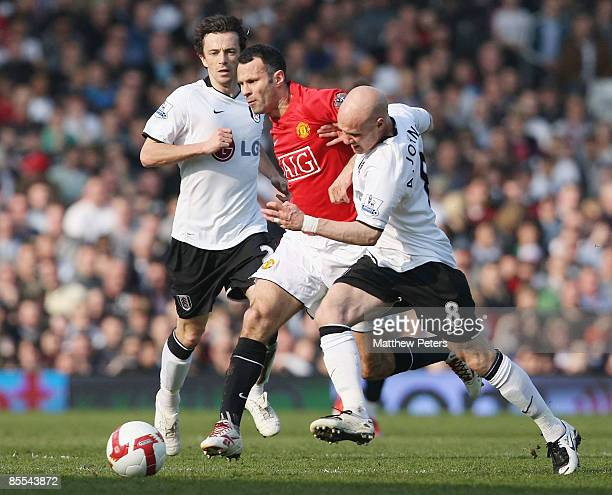 Ryan Giggs of Manchester United clashes with Andy Johnson of Fulham during the Barclays Premier League match between Fulham and Manchester United at...