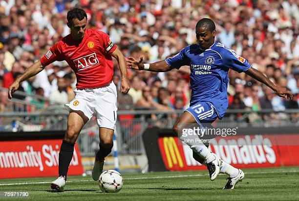 Ryan Giggs of Manchester United clashes with Florent Malouda of Chelsea during the Community Shield preseason friendly match between Chelsea and...