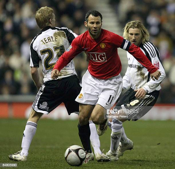 Ryan Giggs of Manchester United clashes with Gary Teale and Robbie Savage of Derby County during the FA Cup sponsored by eon Fifth Round match...