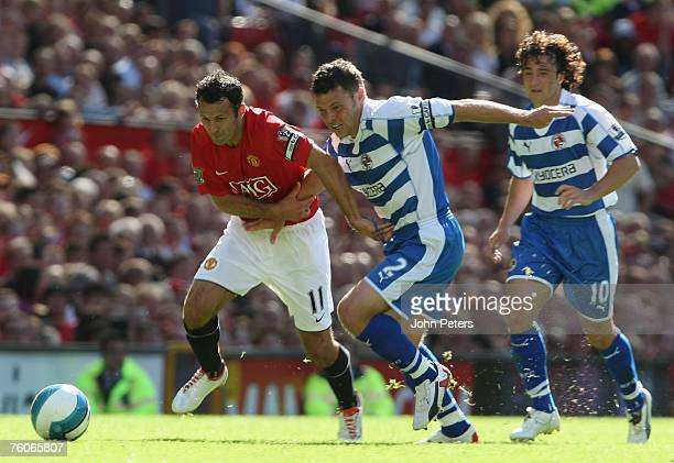 Ryan Giggs of Manchester United clashes with Graeme Murty of Reading during the Barclays FA Premier League match between Manchester United and...