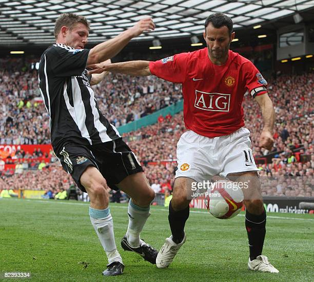 Ryan Giggs of Manchester United clashes with James Milner of Newcastle United during the FA Premier League match between Manchester United and...