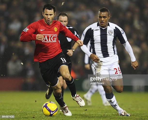 Ryan Giggs of Manchester United clashes with Jay Simpson of West Bromwich Albion during the Barclays Premier League match between West Bromwich...