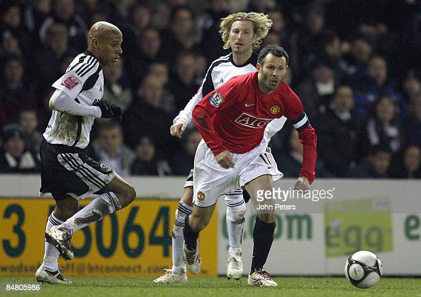 Ryan Giggs of Manchester United clashes with Jordan Stewart and Robbie Savage of Derby County during the FA Cup sponsored by eon Fifth Round match...