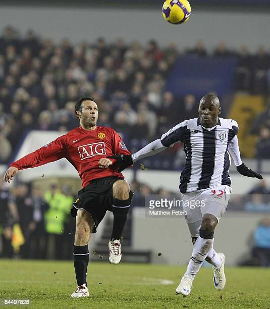 Ryan Giggs of Manchester United clashes with Marc AntoineFortune of West Bromwich Albion during the Barclays Premier League match between West...