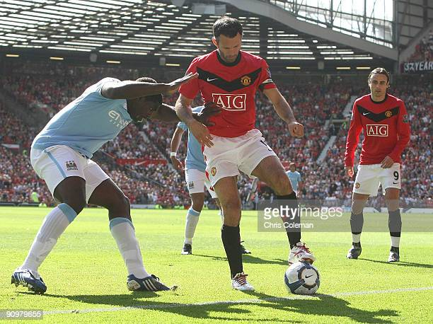 Ryan Giggs of Manchester United clashes with Micah Richards of Manchester City during the FA Barclays Premier League match between Manchester United...