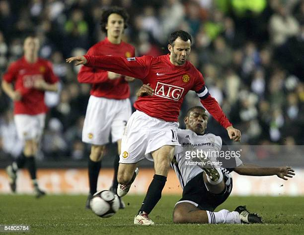 Ryan Giggs of Manchester United clashes with Miles Addison of Derby County during the FA Cup sponsored by eon Fifth Round match between Derby County...