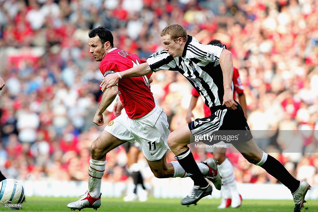 Ryan Giggs of Manchester United clashes with Peter Ramage of Newcastle United during the Barclays Premiership match between Manchester United and Newcastle United at Old Trafford on April 24 2005 in Manchester, England.