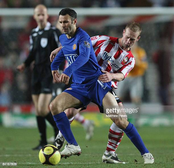 Ryan Giggs of Manchester United clashes with Simon Gillett of Southampton during the FA Cup sponsored by eon Third Round match between Southampton...