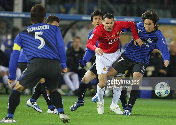 Ryan Giggs of Manchester United clashes with Yasuhito Endo of Gamba Osaka during the FIFA World Club Cup SemiFinal match between Gamba Osaka and...