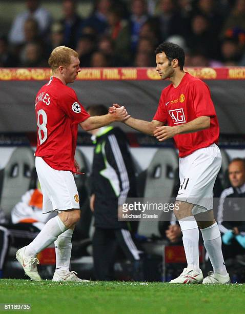 Ryan Giggs of Manchester United comes on as a substitute for Paul Scholes to break Sir Bobby Charltons club record of 758 appearances during the UEFA...