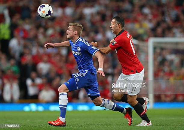 Ryan Giggs of Manchester United competes with Kevin De Bruyne of Chelsea during the Barclays Premier League match between Manchester United and...