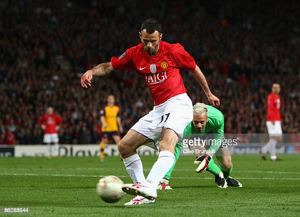 Ryan Giggs of Manchester United goes past Manuel Almunia of Arsenal to put the ball in the net for a disallowed goal during the UEFA Champions League...