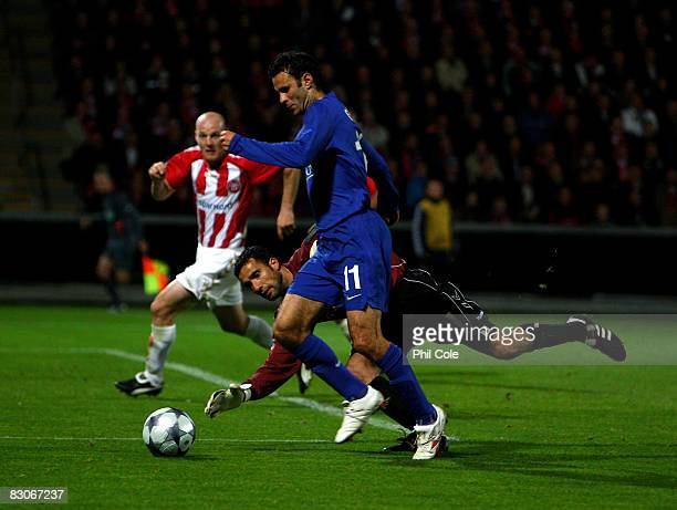 Ryan Giggs of Manchester United goes round Karim Zaza of Aalborg but does not score during the UEFA Champions League Group E match between Aalborg...