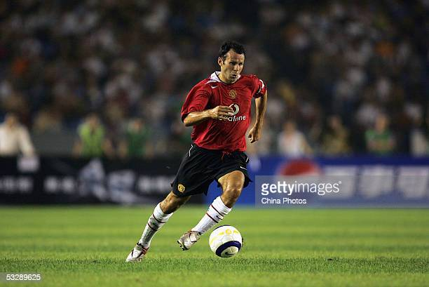 Ryan Giggs of Manchester United in action during a preseason friendly match between Manchester United and Beijing Hyundai at Workers' Stadium on July...