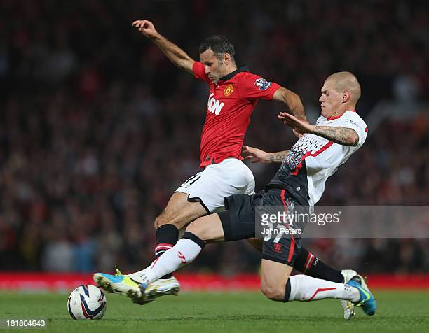 Ryan Giggs of Manchester United in action with Martin Skrtel of Liverpool during the Capital Cup Third Round match between Manchester United and...