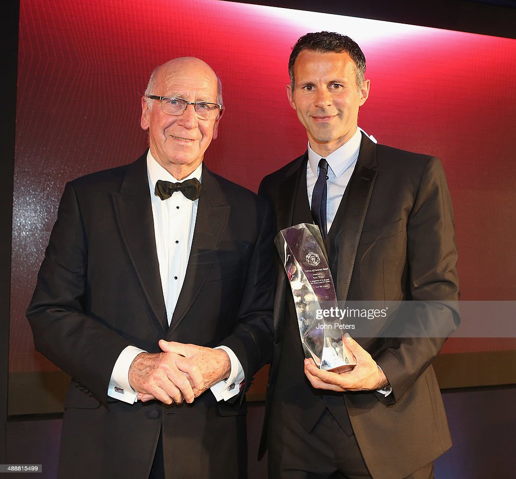 Ryan Giggs of Manchester United is presented with the Lifetime Achievement award by Sir Bobby Charlton at the Manchester United Player of the Year awards at Old Trafford on May 8, 2014 in Manchester, England.