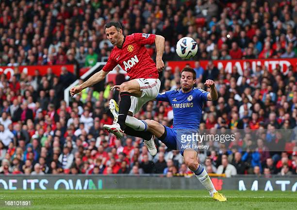 Ryan Giggs of Manchester United is tackled by Cesar Azpilicueta of Chelsea during the Barclays Premier League match between Manchester United and...