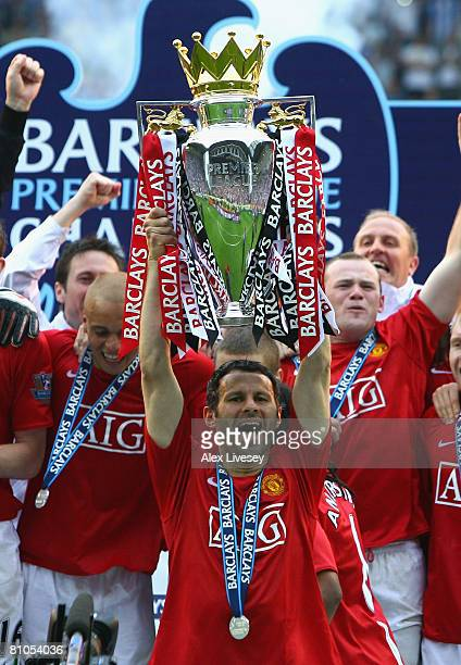 Ryan Giggs of Manchester United lifts the Barclays Premier League trophy following his team's victory at the end of the Barclays Premier League match...
