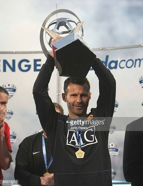 Ryan Giggs of Manchester United lifts the Vodacom Challenge trophy after the Vodacom Challenge preseason friendly match between Kaizer Chiefs and...