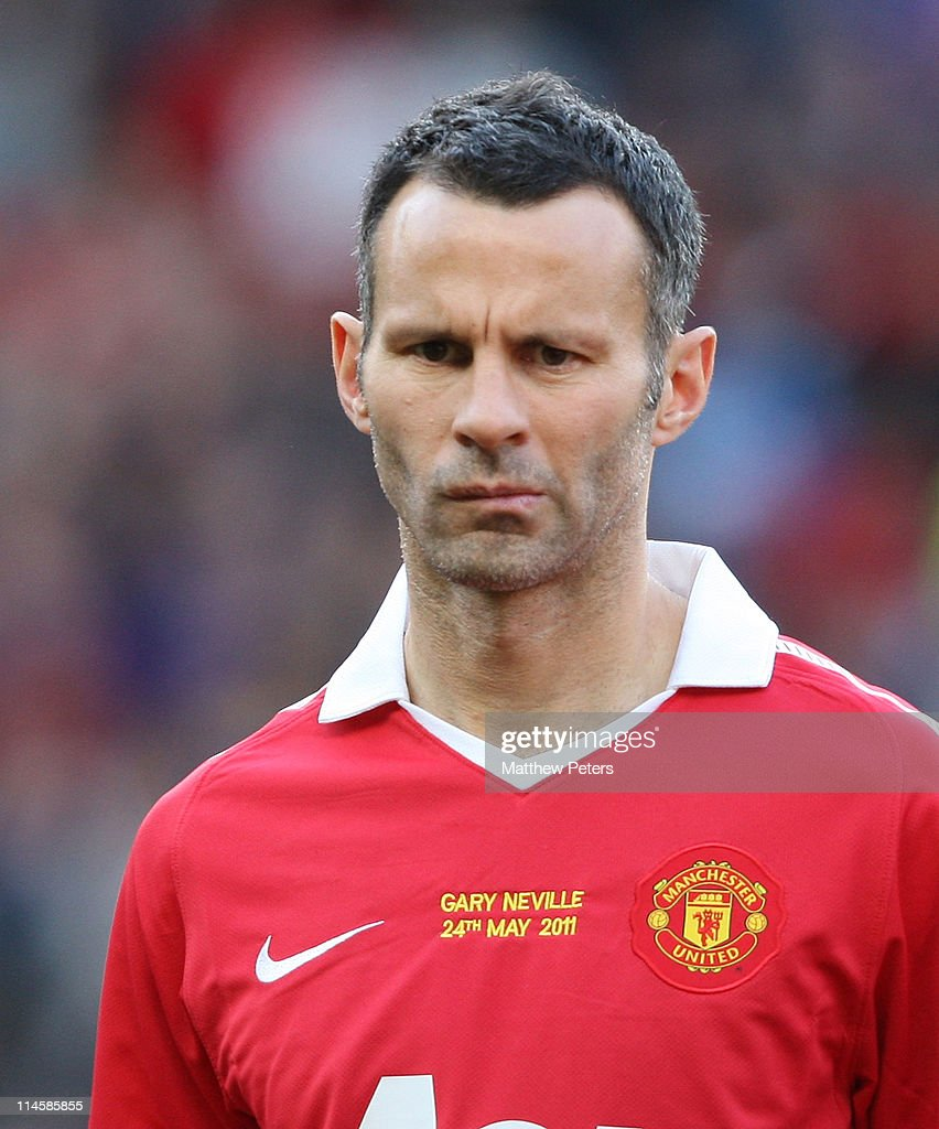 Ryan Giggs of Manchester United lines up ahead of Gary Neville's testimonial match between Manchester United and Juventus at Old Trafford on May 24, 2011 in Manchester, England.