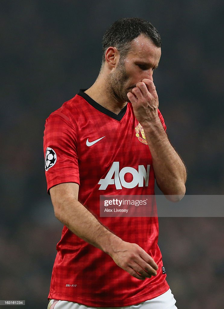 Ryan Giggs of Manchester United looks dejected at the end of the UEFA Champions League Round of 16 Second leg match between Manchester United and Real Madrid at Old Trafford on March 5, 2013 in Manchester, United Kingdom.