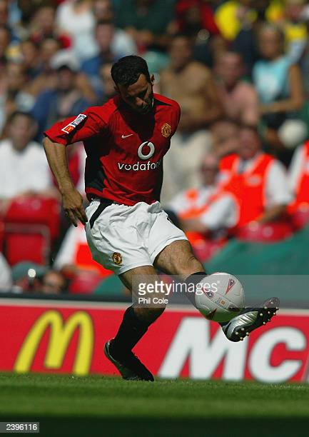 Ryan Giggs of Manchester United passes the ball during the FA Community Shield match between Arsenal and Manchester United held on August 10, 2003 at...