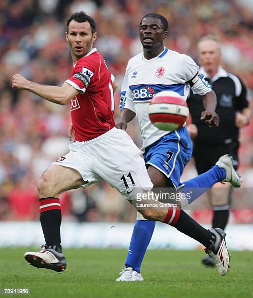Ryan Giggs of Manchester United passes the ball upfield under pressure from George Boateng of Middlesbrough during the Barclays Premiership match...