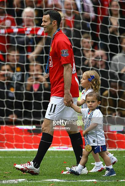 Ryan Giggs of Manchester United performs a lap of honour with his children Liberty and Zach after his side clinched the Premier League title at the...