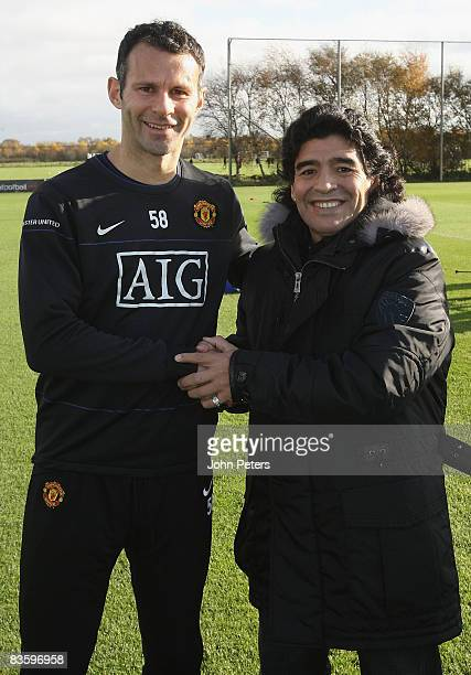 Ryan Giggs of Manchester United poses with Argentine national manager Diego Maradona during a First Team Training Session at Carrington Training...