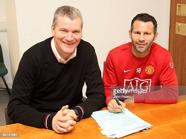Ryan Giggs of Manchester United poses with Chief Executive David Gill after signing a one-year extension to his contract at Carrington Training...
