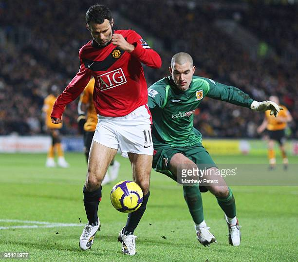 Ryan Giggs of Manchester United rounds Boaz Myhill of Hull City during the Barclays Premier League match between Hull City and Manchester United at...